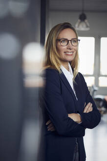 Portrait of smiling businesswoman in office - RBF07508