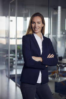 Portrait of smiling businesswoman in office - RBF07511