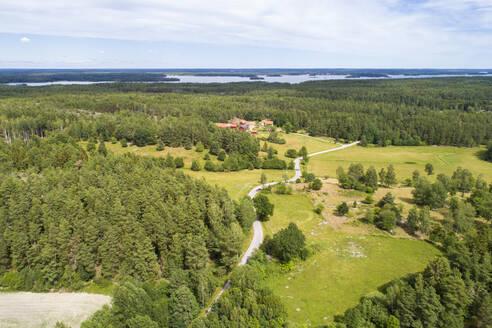Aerial of old highway in the Kalmar in summer with Achipelago - CAVF78790