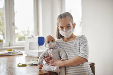Little girl and her doll, wearing self.made face masks - DIKF00428