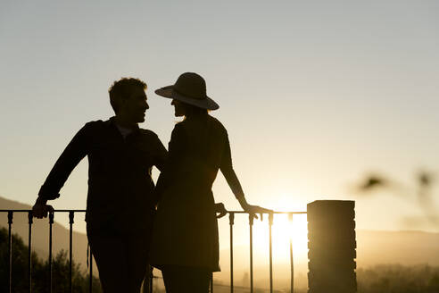 Couple enjoying the sunset in the mountains, Orgiva, Andalusia, Spain - VSMF00062
