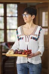 Host serving a healthy vegetarian lunch - VSMF00143
