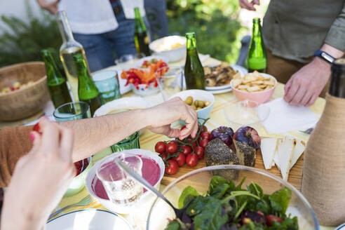 Close-up of friends enjoying healthy lunch outdoors - VSMF00149