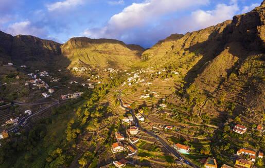 Spain, Santa CruzdeTenerife,ValleGran Rey, Aerial view of village in mountain valley at dusk - SIEF09745