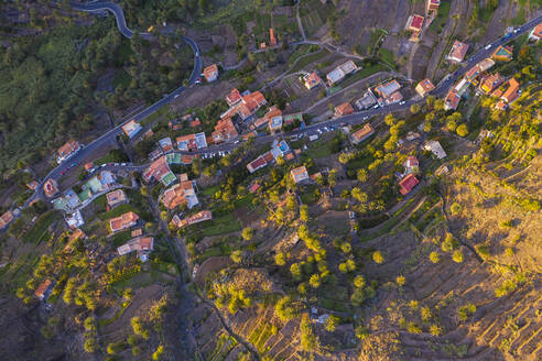 Spain, Santa CruzdeTenerife,ValleGran Rey, Aerial view of village houses on LaGomeraat dusk - SIEF09748