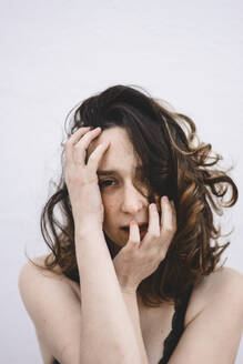Portrait of young woman with hands on her face - FVSF00060