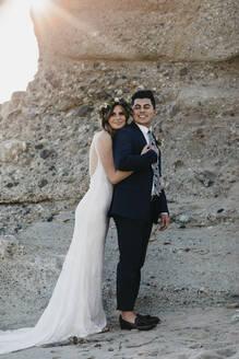 Happy bridal couple at the beach - LHPF01250