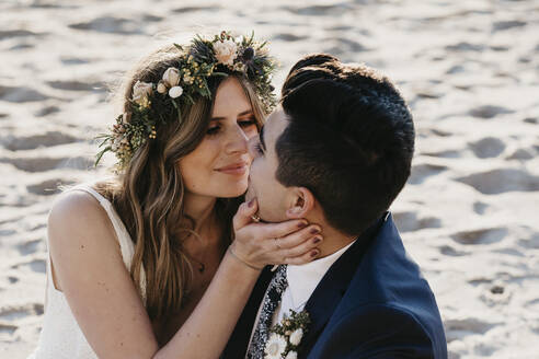 Happy bridal couple kissing each other - LHPF01259