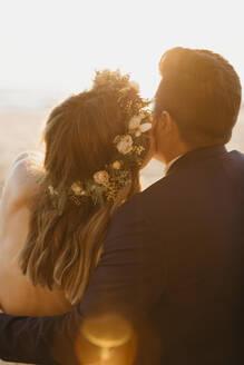 Happy bridal couple at the beach - LHPF01262