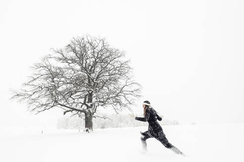Young woman running in winter landscape - WFF00310