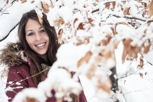Portrait of happy young woman enjoying nature in winter - WFF00313