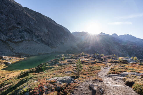 Switzerland, Canton of Grisons, Albula Pass at autumn sunset - HBIF00094