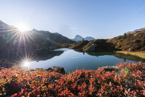 Switzerland, Canton of Grisons, Shore of Crap Alv Lajets lake at autumn sunset - HBIF00097