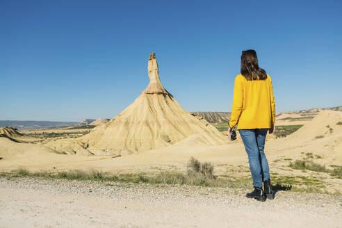 Woman in desertic landscape of Bardenas Reales, Arguedas, Navarra, Spain - XLGF00003