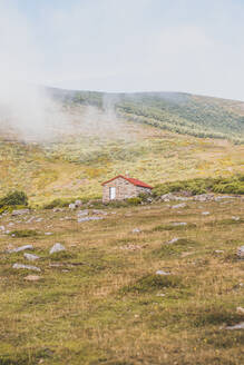Spain, Cantabria, Fog floating over secluded hut - FVSF00117
