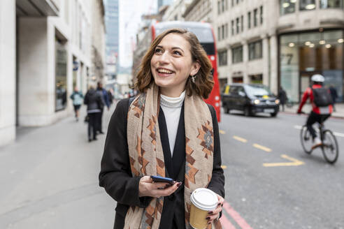 Portrait of happy woman in the city, London, UK - WPEF02762