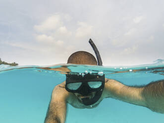 Man snorkeling on the water surface - WPEF02806
