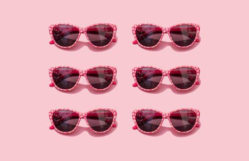 Pink retro sunglasses against pastel pink background - GEMF03556