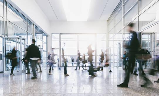 Blurred Motion Of People Walking On Floor - EYF03830