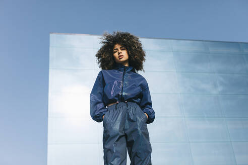 Portrait of stylish young woman wearing tracksuit outdoors - AGGF00023