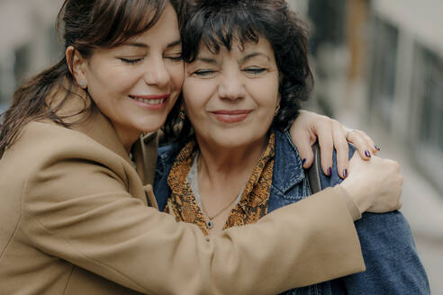 Portrait of happy woman hugging her mother - OGF00277