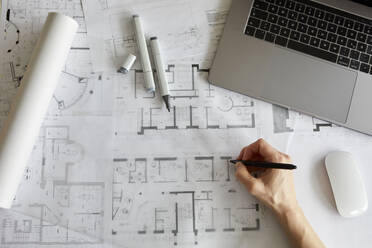 Architect working on construction plan - RBF07550