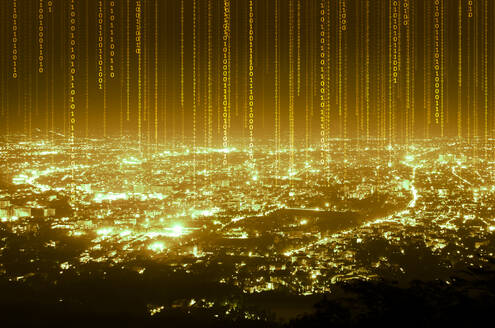 Illuminated Binary Codes Over Cityscape Against Sky At Night - EYF04449