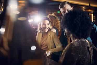 Happy friends socializing in a bar - ZEDF03256