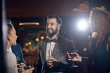 Happy friends socializing in a bar - ZEDF03280