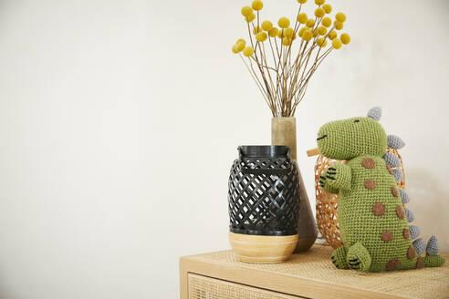 Dragon soft toy on sideboard - FSF01029