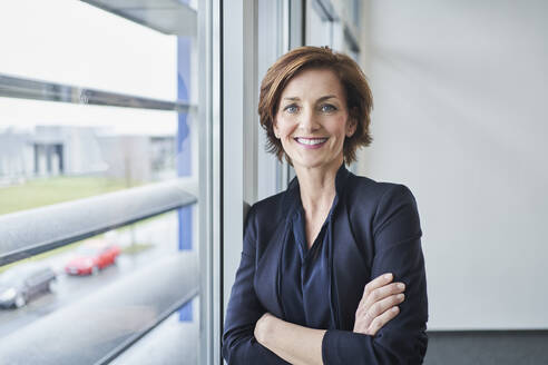 Portrait of confident businesswoman at the window - RORF02121