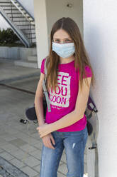 Girl on her way to school with protective mask - SARF04537