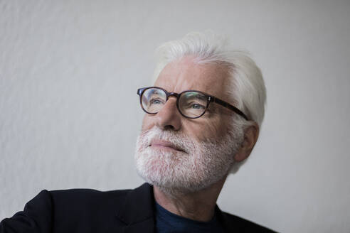 Portrait of bearded senior man with white hair looking at distance - JOSEF00264