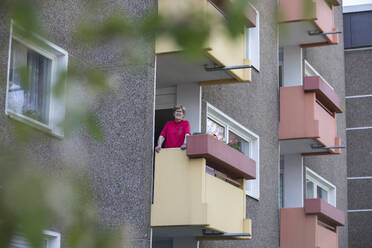 Senior woman on balcony, retirement home - JATF01192