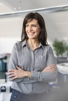 Portrait of confident businesswoman in office - DIGF09686