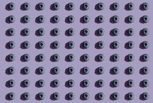 Blueberries in a row, pattern on purple background - GEMF03591
