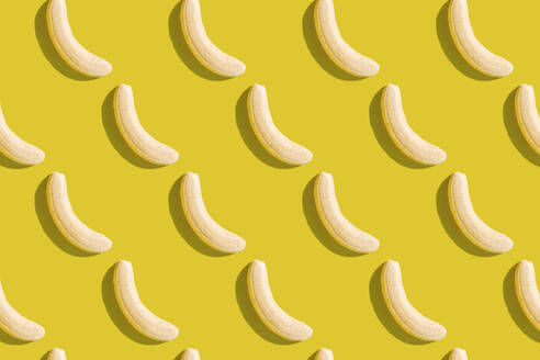 3D illustration of peeled bananas on yellow background - GEMF03598