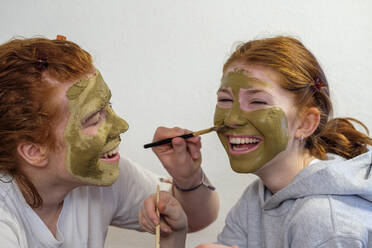 Brother applying facial mask on his sister's face - LBF03044