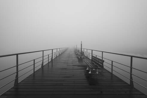 Portugal, Lisbon,Tagus River walkway shrouded in thick fog - RPSF00289