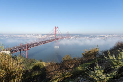 Portugal, Lisbon, 25 de Abril Bridge during foggy weather - RPSF00292