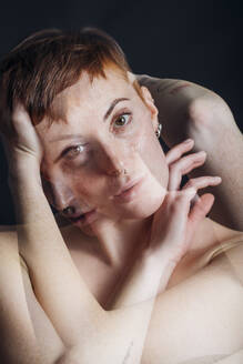Double exposure portrait of nude young woman in studio - MEUF00544