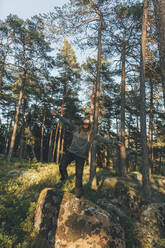 Young woman using VR goggles in nature - GUSF03768