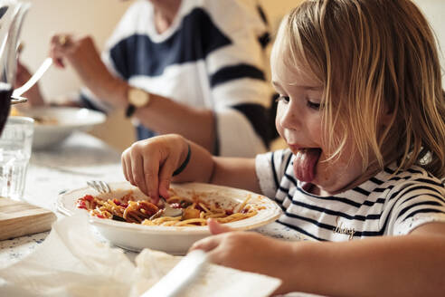 Portrait of little girl eating Spaghetti - WFF00369