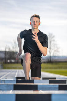 Athlete crossing a hurdle - STSF02511