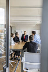 Businesswoman leading a meeting in office - PESF02020