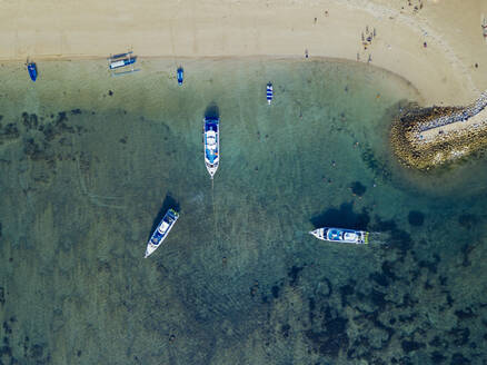 Indonesia, Bali, Sanur, Aerial view of boats moored in front of sandy coastal beach - KNTF04571