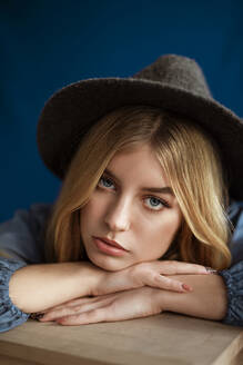 Portrait of blond woman wearing hat looking at camera - AGGF00061