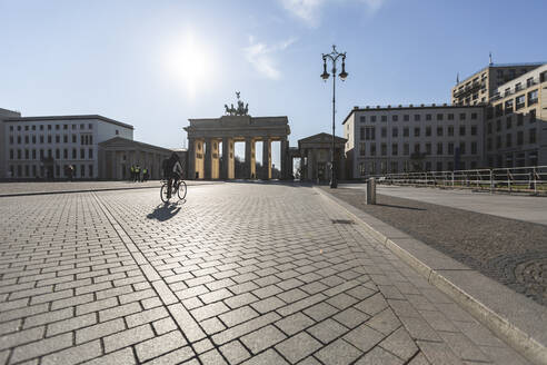 Germany, Berlin, Cobblestone square in front of Brandenburg Gate during COVID-19 epidemic - ASCF01284