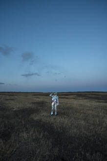 Spacewoman on meadow in the evening - VPIF02387