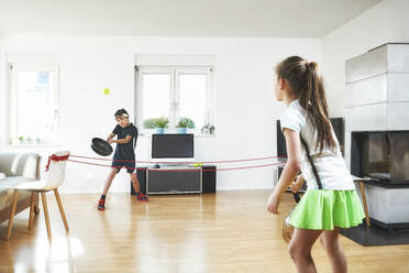 Siblings enjoying tennis at home during pandemic situation - DIKF00468